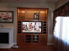 This Is A Natural Cherry Entertainment Center With Lighting